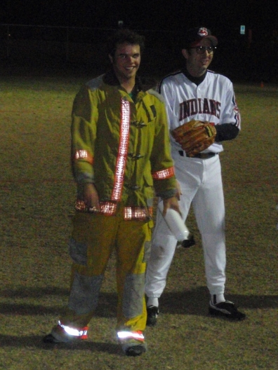 players costumed as a fire fighter and baseball player